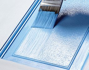 Paint the door panels with a roller, then brush them out.