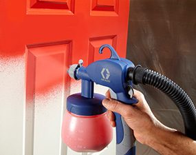 Painting doors goes faster with a paint sprayer.