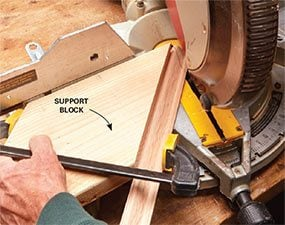 The solution to this finish carpentry problem is to clamp the piece to an angled block.