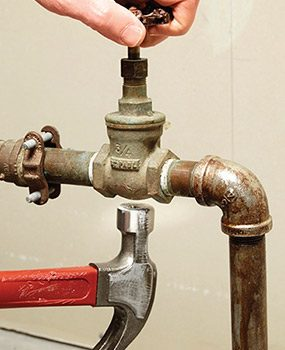 Tap the gate valve gently as you try to reopen it.