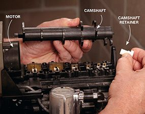 Begin the water softener repair by removing the camshaft.