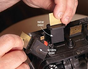 Photo 4 shows how to install the new valve discs for the water softener control head.