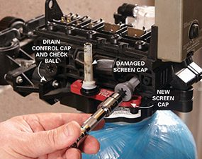 Replace the screen to complete the water softener repair.