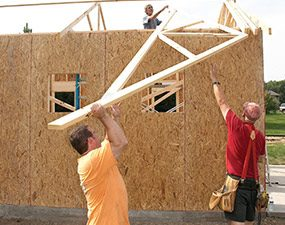It's easier to frame the garage roof if you slide the trusses up on their sides and stack them.