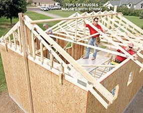 Use three people to set and nail the trusses.