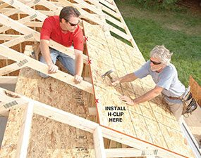 After framing the garage roof, install the decking.