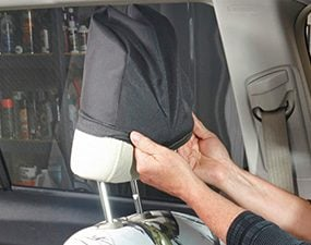 Install a new headrest cover to match the seat covers.
