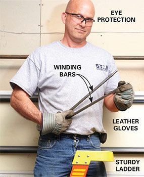 Make sure you have the proper winding bars and safety equipment when you make overhead garage door repairs.