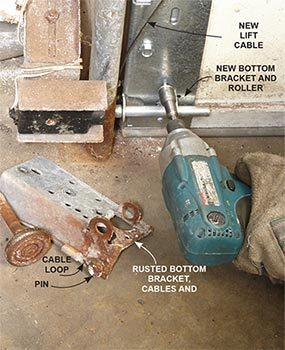 Replace the rusted parts at the bottom of the overhead garage door.