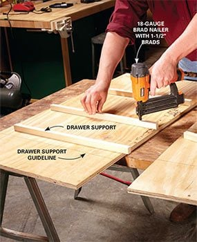 Add the drawer supports to the side panels of the DIY garage storage drawers.