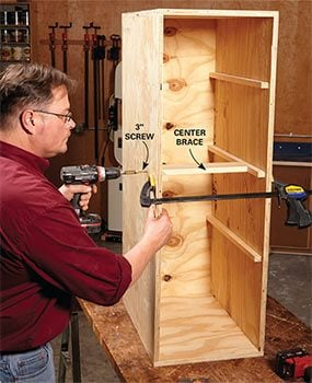 Add a brace at the center of the DIY garage storage cabinet.