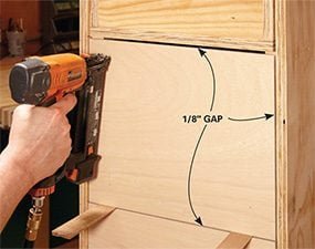 Add the fronts to the DIY garage storage drawers.