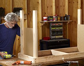 Attach the legs to the frame of the DIY workbench.