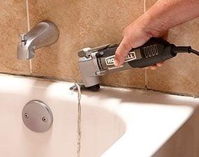 Photo 1 shows how to remove old caulk when you recaulk a shower.