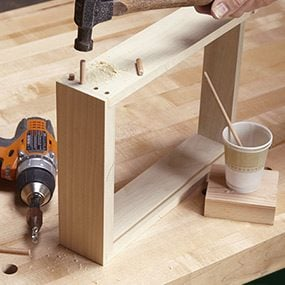 Glue in pegs for the drawer front of the end table.