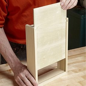 Slide the drawer bottom into the end table drawer.