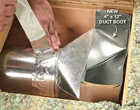 After cutting the opening, install a larger duct boot that fits the duct booster fan.