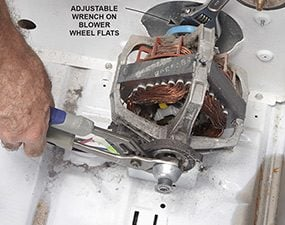 The dryer motor is responsible for making the loud noise, so clamp it and begin the removal process.