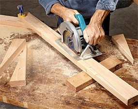 Rip a 2x4 diagonally to create the sides