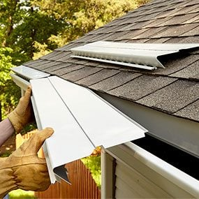 Slip under shingles and screw to gutters