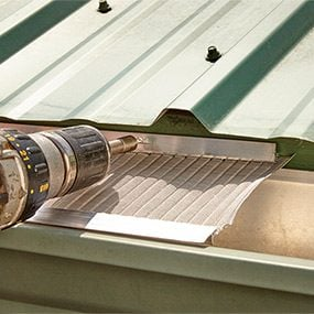 The best leaf guard gutters for your home family handyman option two solutioingenieria Choice Image