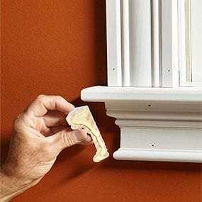 Buy primed trim if you're painting