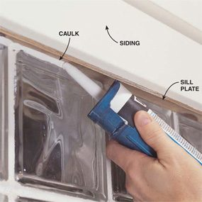 Photo 7: Caulk Around The Window