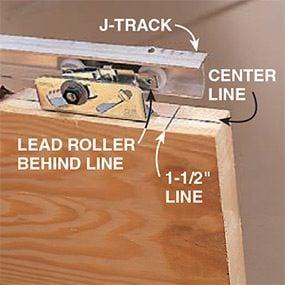 Detail shot showing rollers attached to door top and installed in door track when repairing a pocket door.
