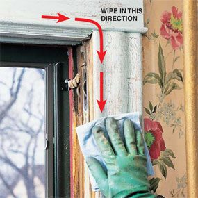 Continue the cleanup after the lead paint removal by wiping down the surfaces with the wet paper towel.