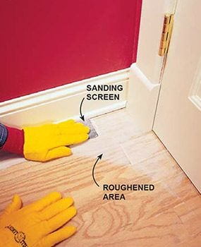 Sand the corners by hand when you're refinishing hardwood floors.