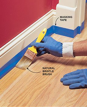 Start refinishing the hardwood floor by cutting in along the edges.