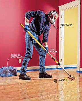 Refinish the hardwood floor with an applicator pad.