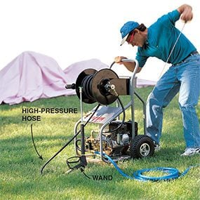 Attach a hose to supply water for pressure washing the house.