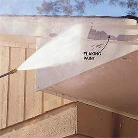 Paint will flake as you pressure wash a house, but you still have to scrape.