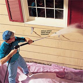 Aim away from windows as you pressure wash the house.