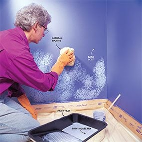 Begin sponge painting the wall with the first color.