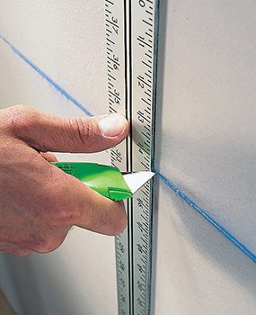 Use your T-square to make quick rip cuts when you hang drywall.