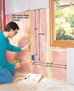 Make electrical box cutouts carefully when you hang drywall.