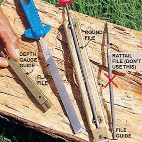 The four tools for sharpening a chain saw: a round file mounted in a file guide, a flat file, and a depth-gauge guide.