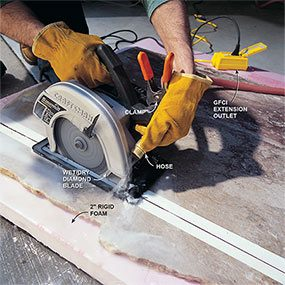 Cutting marble with a circular saw.