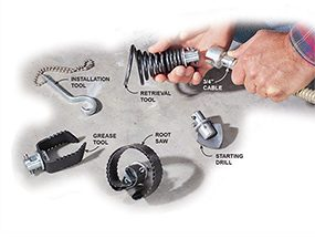 A drain-cleaning machine uses different attachable tools to unclog drains.
