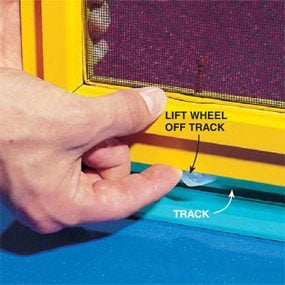 Lifting a sliding screen door's wheel out of its track.