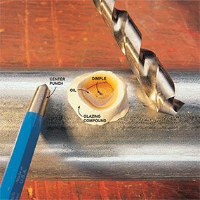 Keeping lubricating oil in place with a ring of glazing compound when drilling through metal.
