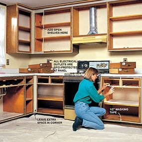 Get a better idea of how to refinish your kitchen cabinets by mimicking drawer spacing with masking tape.
