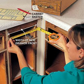 Measure for the new doors and drawers you'll need when you refinish the kitchen cabinets.
