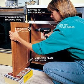 Align and then screw the kitchen cabinet doors to the frame.