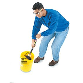 Spinning a paint brush in a pail when cleaning a paint brush.