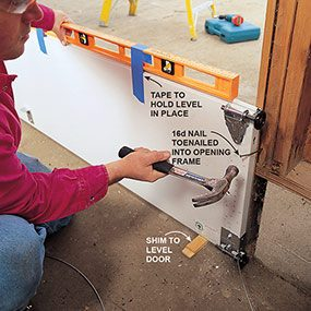 Photo 3 shows how to install the first section of the new garage door.
