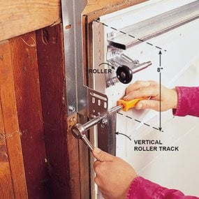 Install the roller tracks for the new garage door.