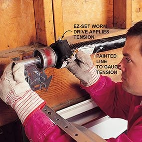 Photo 7 shows how to install the spring and bar for the new garage door.